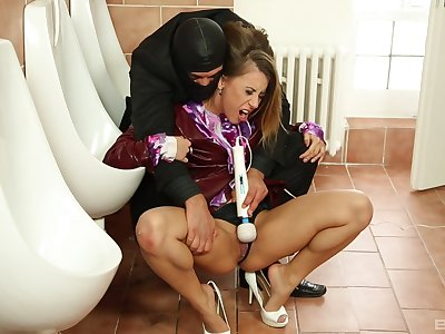 Nikky Thorne gets her pussy pleased by a dude in the public toilet
