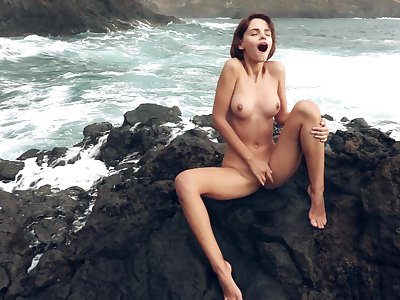 Exalted outdoor masturbation with Ariela, as waves crash in a difficulty backdrop